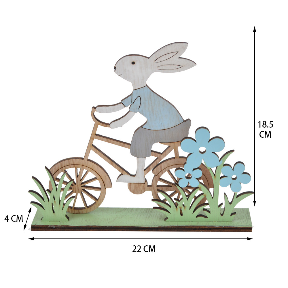 wooden Easter spring bunny rode his bicycle in the grass tabletop decoration